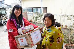 AAR staff delivering diapers and other relief items to a church preschool in Ishinomaki.