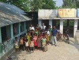 Jamie with the teachers and students of Lalkuthi, on the completed pavement