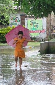 Our neighbor playing in the streets after the first big rainfall (Photo by Jamie)