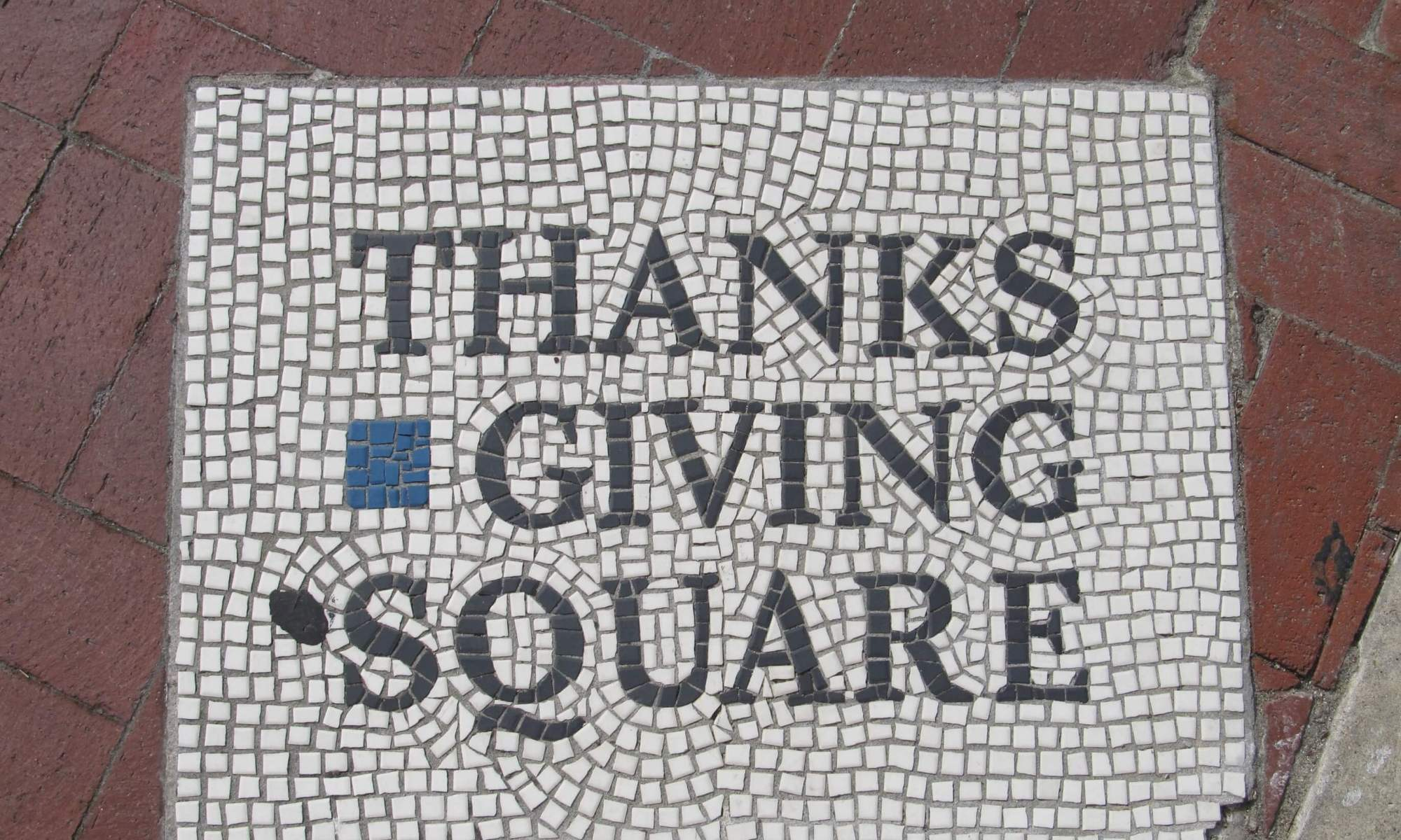 thanksgiving square written in mosaic tiles