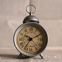 old fashioned style alarm clock with roman numerals