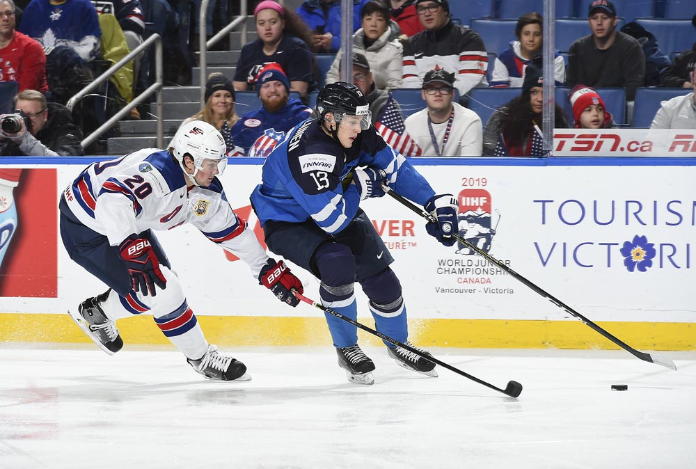 f53ce31e1 ... Andrew Peeke  20 chases him down during preliminary round action at the  2018 IIHF World Junior Championship. (Photo by Matt Zambonin HHOF-IIHF  Images)