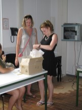 Juliana and Anika open the parcel