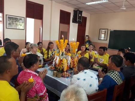 Traditional Baci ceremony in the dancing room of Ban Sikeud Primary School