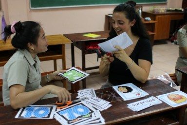 Ms Mittaphone and Hanna cut the laminated flashcards and word cards