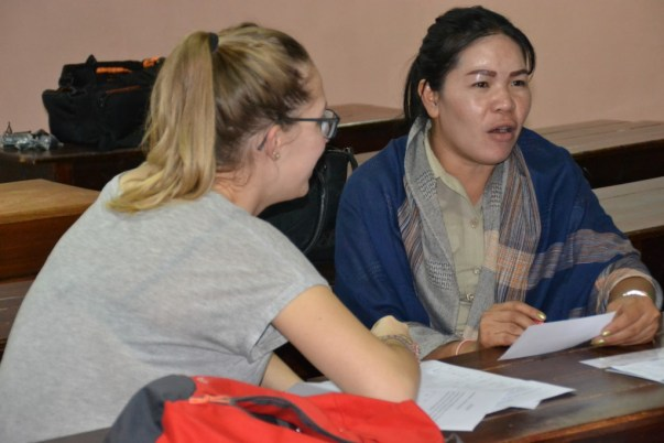 Ms Bounpheng and volunteer-assistant Maggy work on a word dictation