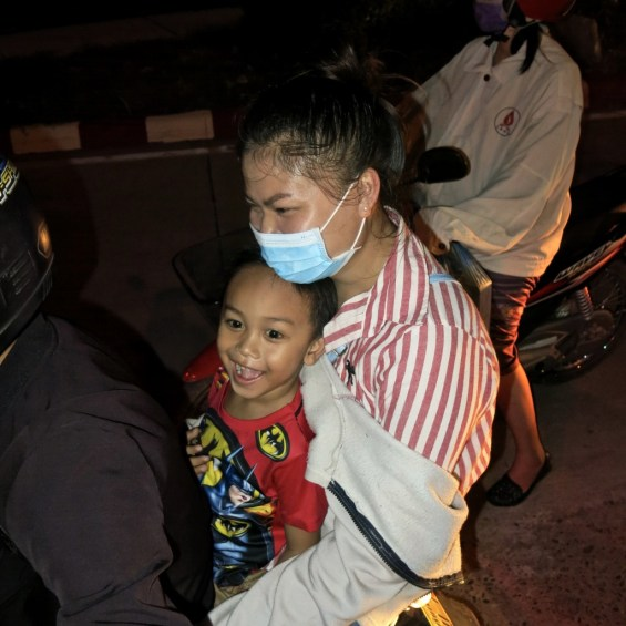 Boy and his mother on a scooter, Vientiane