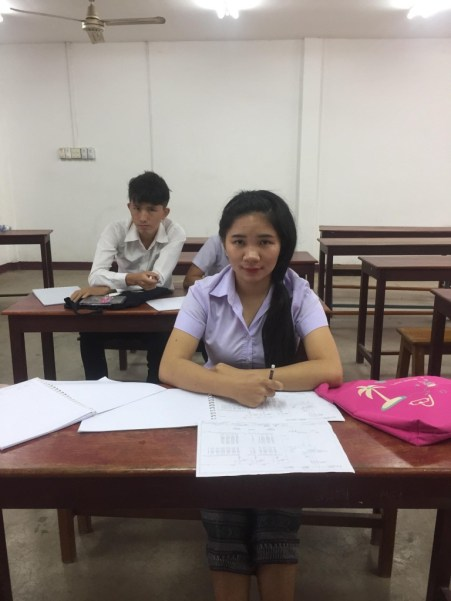Ms Toukta sits in class studying with her peer Lee Lor.