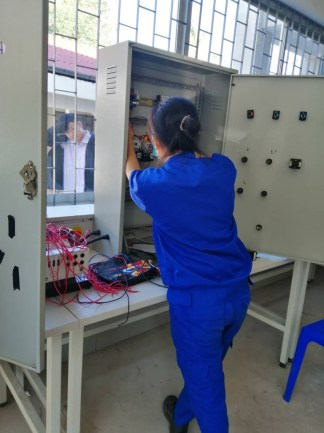 Ms Panhia works on a junction box, gets some practical training...