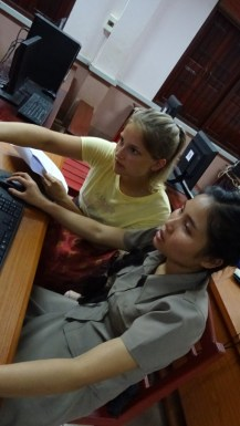 Rebekka works with Ms Khamsee Thanbounhueang on her worksheet.