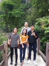 Near Buddha Cave at Thakhek City, Khammoaune Province. My third younger sister on my right hand side and my youngest brother on my left hand side