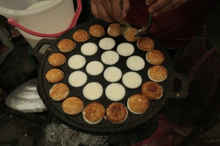 Coconut Pancakes fried in a pan