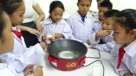 Pupils mix the ingredients...