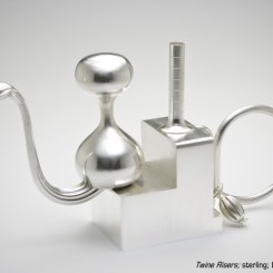 """""""Twin Risers,"""" sterling silver by Tom Muir, 2007. Photo by Tim Thayer."""