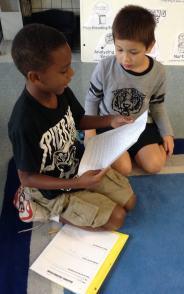 Khalani read his piece about a trip to Branson to Thomas.