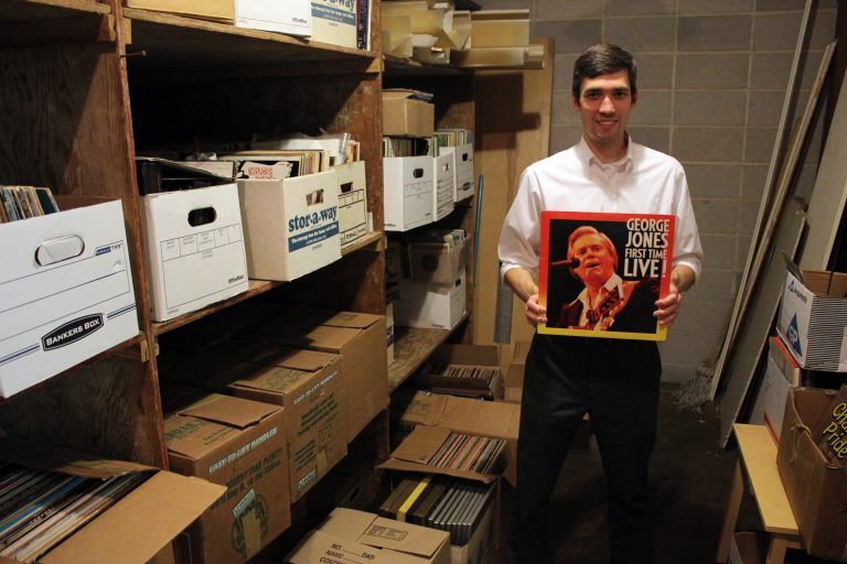Record sale organizer Chris Brown holds a George Jones record