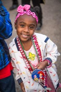 A photo of a kid at Mardi Gras