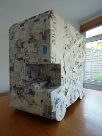 ...with paper mache, catching the latest news...