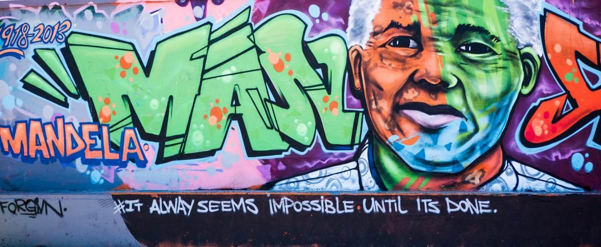 Graffiti of Nelson Mandela with one of his most famous quotes: it always seems impossible untill it's done