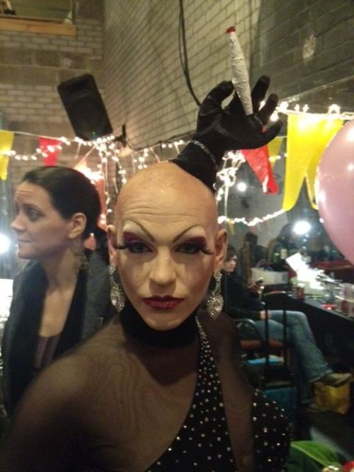 Victoria DeVille with her joint head piece. backstage before her 3rd quick change.  ©Frenchie Kiss