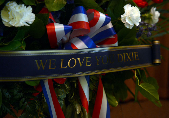 A banner surrounded by patriotic colours at the Dixie Evans memorial service.  ©Jennifer Cappuccio Maher/Inland Valley Daily Bulletin