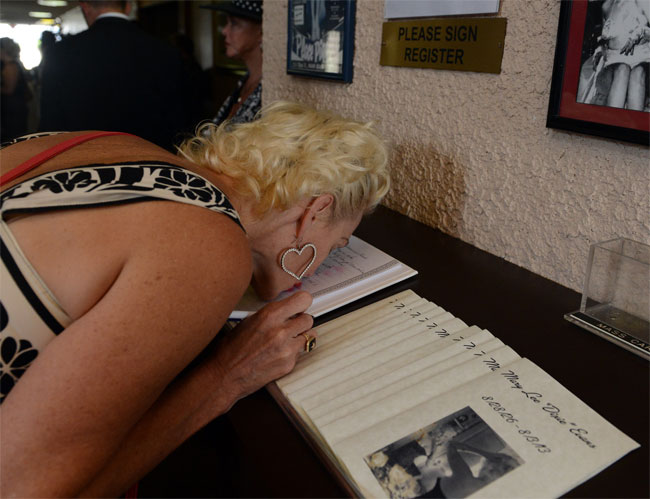Kitten DeVille signing the book of condolence at the Dixie Evans memorial service.  ©Jennifer Cappuccio Maher/Inland Valley Daily Bulletin