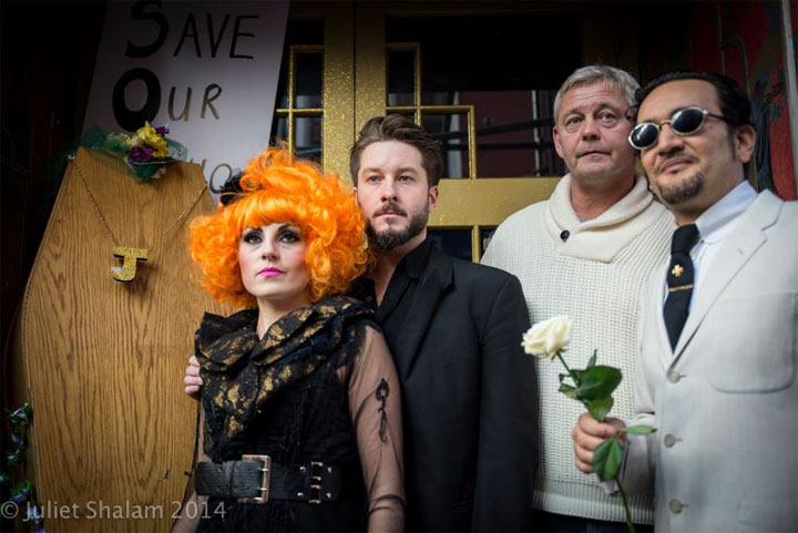 Abigail O'Neill, Alexander Parsonage, Paul Raymond's son Howard Raymond and Soho Hobo Tim Arnold stand at the doors of Madame Jojo's with coffin and wreaths.  ©Juliet Shalam