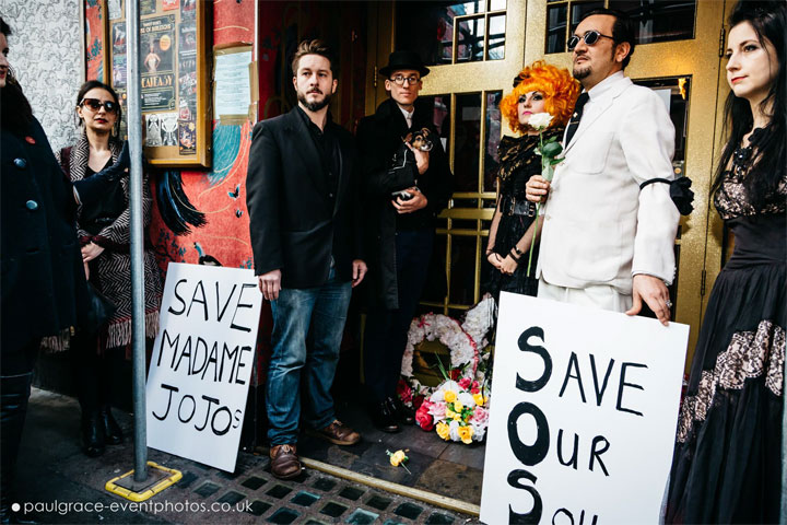 Alexander Parsonage, Abigail O'Neill and Soho Hobo Tim Arnold stand at the doors of Madame Jojo's with wreaths and banners.  ©Paul Grace (www.paulgrace-eventphotos.co.uk)