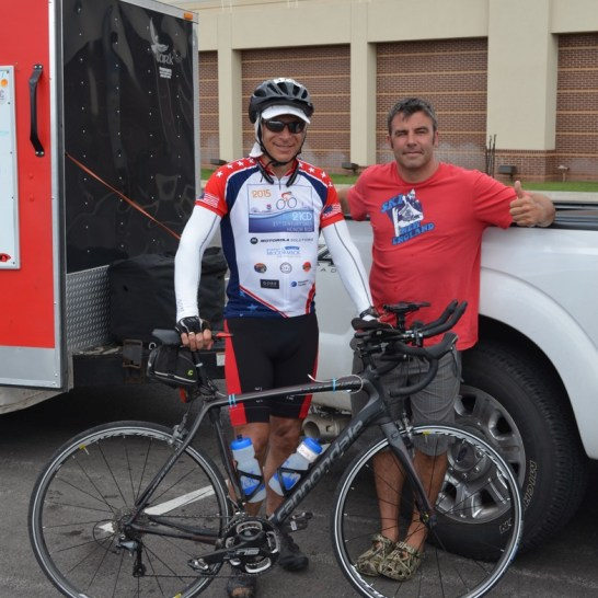With Lincoln Baker, the Dads Honor Ride, ride director outside of Pribil Stadium home of the Bishop McGuinness Catholic High School Fighting Irish in Oklahoma City.