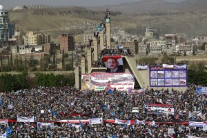 Yemenis display giant banners bearing portraits of former president Ali Abdullah Saleh during a protest against the Saudi-led coalition, commemorating one year of the alliance's military campaign against insurgents on March 26, 2016 next to the Monument to the Unknown Soldier in the Yemeni capital Sanaa. The protest was called for by the General People's Congress, the party of rebel-allied former president Ali Abdullah Saleh, who appeared briefly at the rally, an AFP photographer said. The military intervention that began on March 26 last year has yet to deal a decisive blow to the Iran-backed rebels, who continue to control the capital and large parts of the country. / AFP / MOHAMMED HUWAIS
