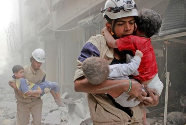 1 members-of-the-white-helmets-rescue-children-from-an-attack-in-june__939593_