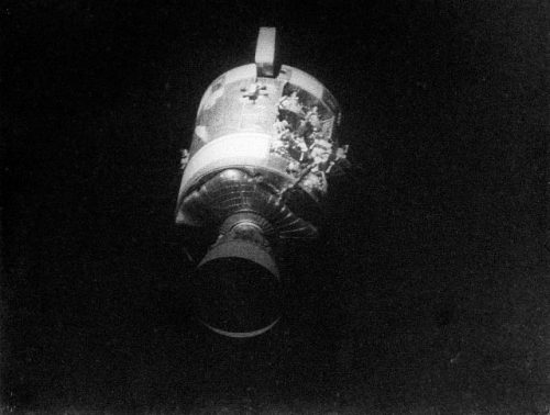"""AS13-59-8500A (17 April 1970) --- This view of the severely damaged Apollo 13 Service Module (SM) was photographed from the Lunar Module/Command Module (LM/CM) following SM jettisoning. As seen in this cropped image, enlarged to provide a close-up view of the damaged area, an entire panel on the SM was blown away by the apparent explosion of oxygen tank number two located in Sector 4 of the SM. Two of the three fuel cells are visible just forward (above) the heavily damaged area. Three fuel cells, two oxygen tanks, and two hydrogen tanks are located in Sector 4. The damaged area is located above the S-Band high gain antenna. Nearest the camera is the Service Propulsion System (SPS) engine and nozzle. The damage to the SM caused the Apollo 13 crew members to use the LM as a """"lifeboat"""". The LM was jettisoned just prior to Earth re-entry by the CM. Photo credit: NASA"""