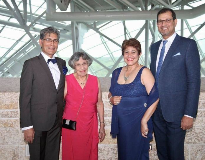 Denzil Smith (left) with his mother, sister Cheryl Roy Smith and brother Lionel Smith