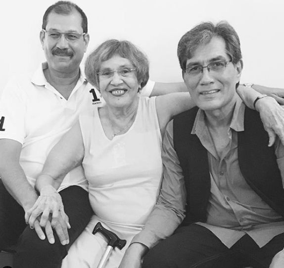Denzil Smith (right) with his mother and brother, Lionel Smith