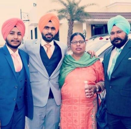 Simranjeet Singh with his parents and brother (Arsh)