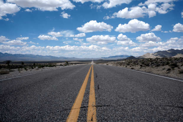 photo shows a desert highway with