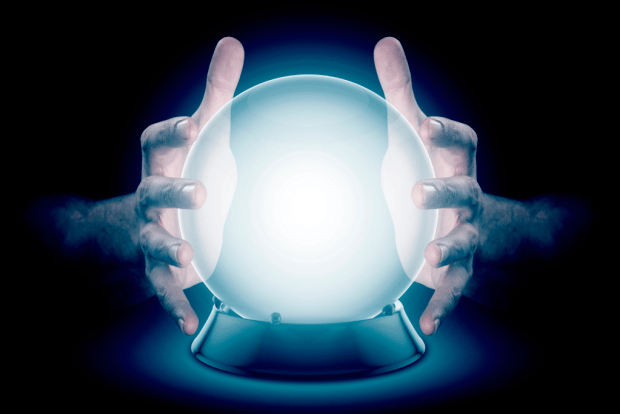 photo shows hands around a glowing blue crystal ball