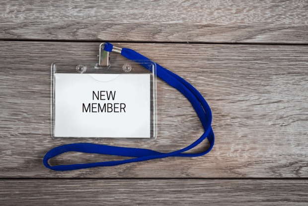 "photo shows a badge reading ""new member"""