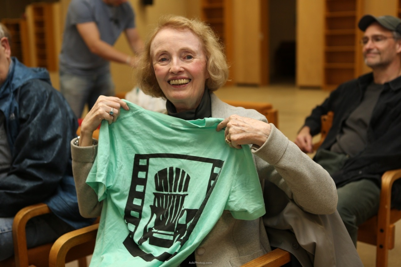 New York Daily film critic holds up her Lake Placid film shirt