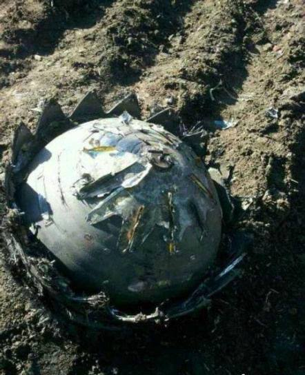 This from Heilongjiang, China, where reports of UFOs have been abundant over the past few hours.. The photo you are looking at is reportedly a metallic ball that crashed into the town—two similar objects were spotted falling from the sky in a neighboring county.. Reports also indicate that residents heard a loud piercing noiseas the objects fell to the earth. They also say they saw something looking like a fireball slamming into a vegetable patch .. The places where the objects have fallen have reportedly been blocked by Chinese government officials—no word officially on what they are nor is there word on whether they REALLY are, or if this is some strange net hoax that I and others have fallen for.. The photos below are from CHINANEWS.COM and show what appears to be some sort of Chinese government official or scientist in bright orange protective clothing as he/she inspects the object.. Perhaps related (MAYBE): There are also reports that a Russian rocket has broken up after its launch..