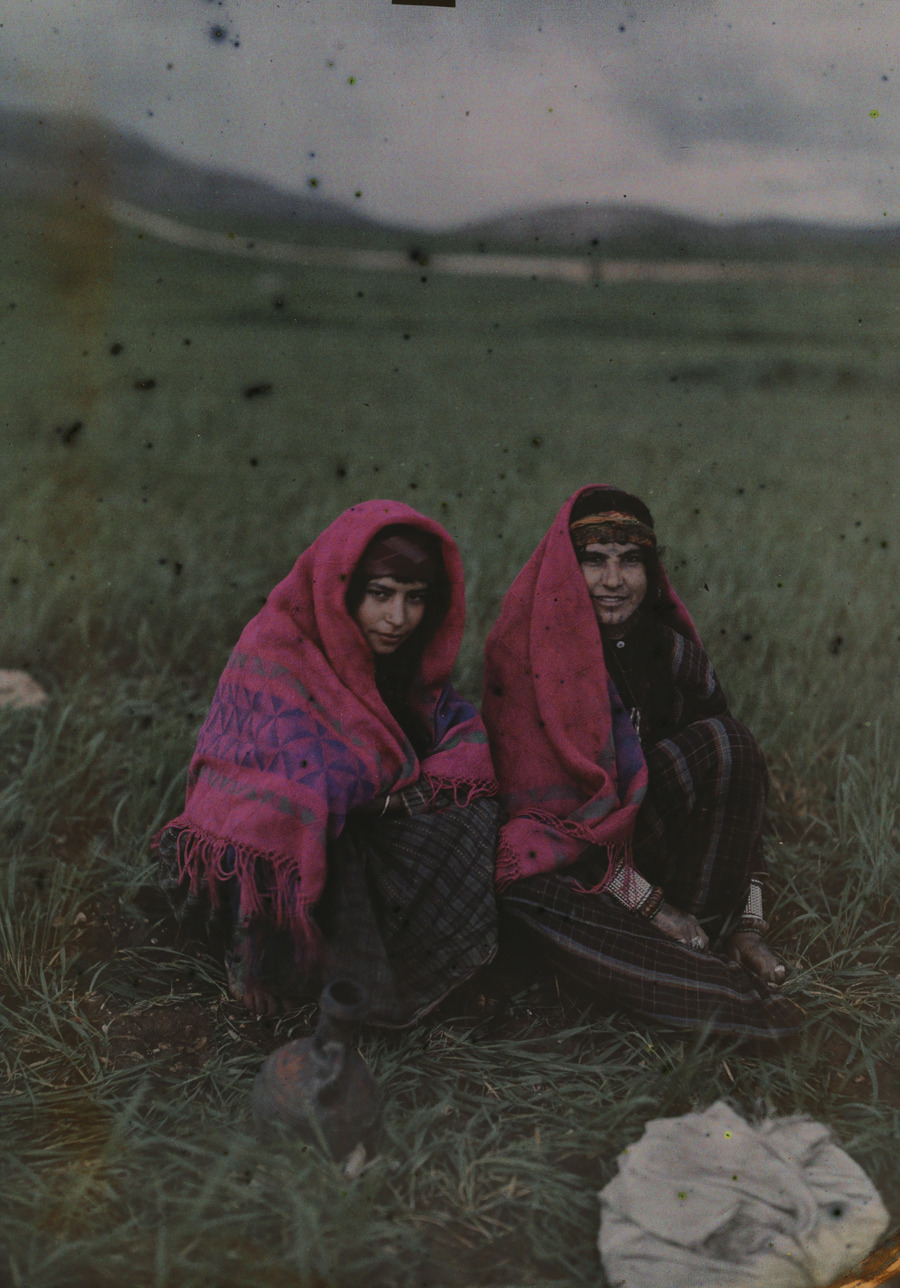 Two girls wearing shawls pose for a portrait in Huwara, Palestine, 1926.Photograph by Maynard Owen Williams, National Geographic