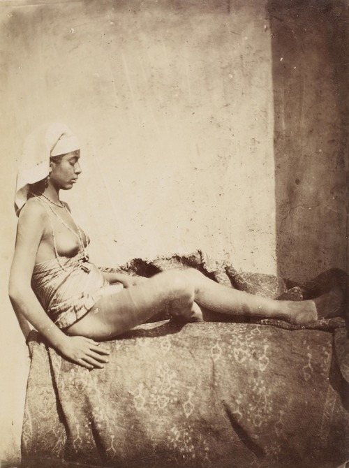 les-sources-du-nil:  Rudolph Carl Huber (circle of) [Nude woman sitting on carpet with her back against a wall]Cairo, Egypt, 1875-1876 (Ken & Jenny Jacobson Orientalist Photography Collection)