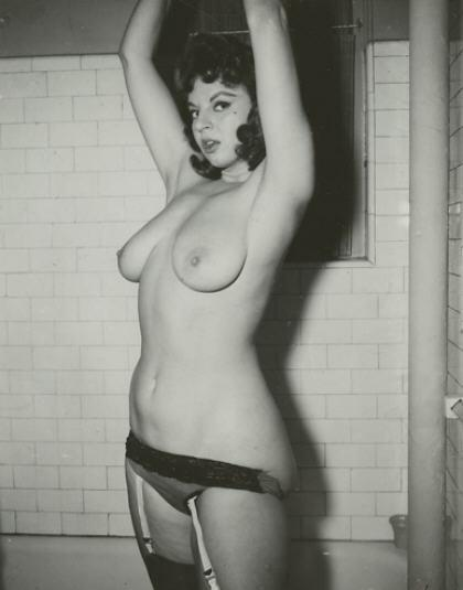 Hot retro babe with a nice set of jugs. What, was she caught in the boys bathroom (again)?