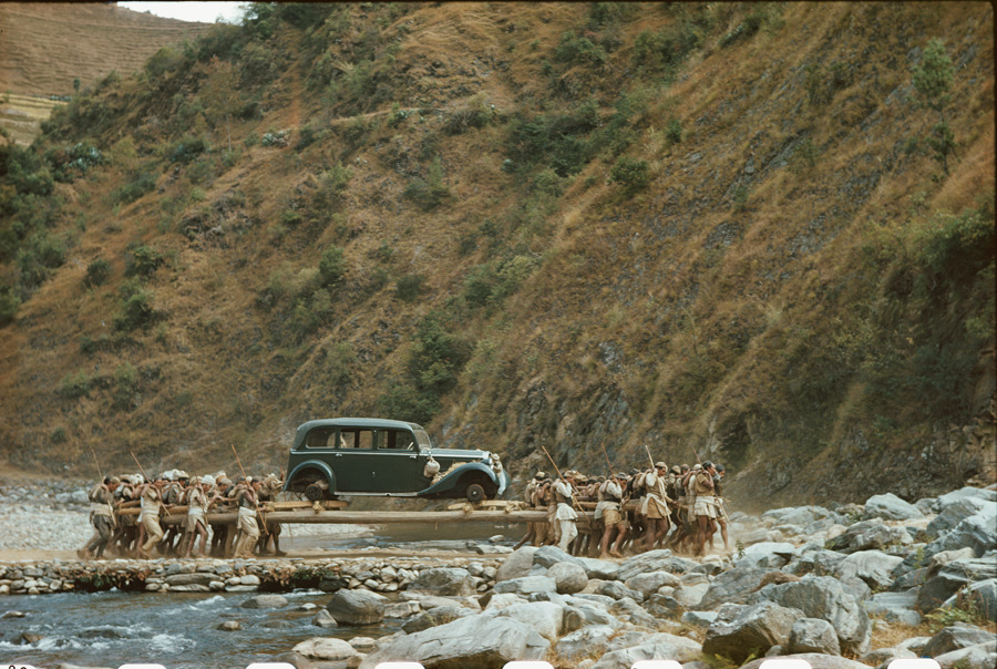 Porters transport a car on long poles across a stream in Nepal, January 1950.Photograph by Volkmar K. Wenztel, National Geographic