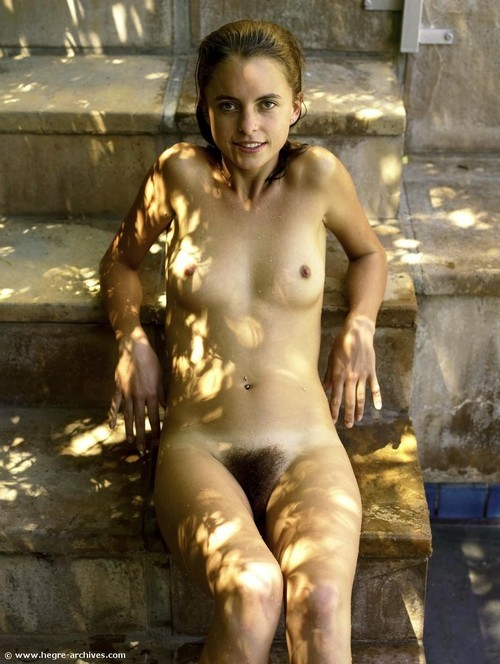 Lovely nude young woman in dappled sunlight.