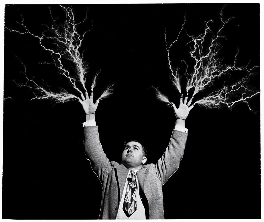"Electricity flashes from the thimble-topped fingers of a ""preacher-scientist,"" August 1955.Photograph by the Moody Bible Institute"