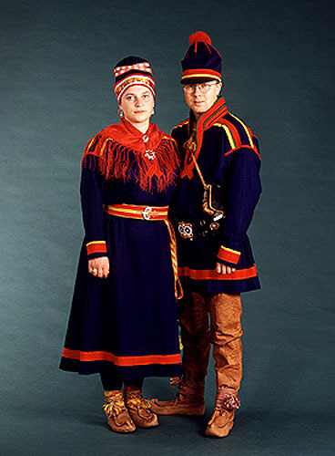 The Samer are the indiginous people of northern Scandinavia ( arriving long before what would become the Germanic ethno linguistic group). They are Finnic and thus related to Finns, Estonians and so on. They have many dialects, costumes and groups and where originally nomadic connected to the raindeers grazing grounds. They dont ALWAYS wear folk costume today any more than Scotsmen wear kilts obviously. Viking Age Norse where in contact with them, traded and perhaps fought. There are theories that the Seidr and Galdr magic forms might have been influenced by the Samer. Sami flag