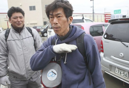 From the LA Times:   Hideaki Akaiwa, in Miyagi prefecture, has decided not to wait for rescue workers. With a scuba suit on, he waded through flooded streets to rescue his wife, and later his mother. He continues to look for more survivors.