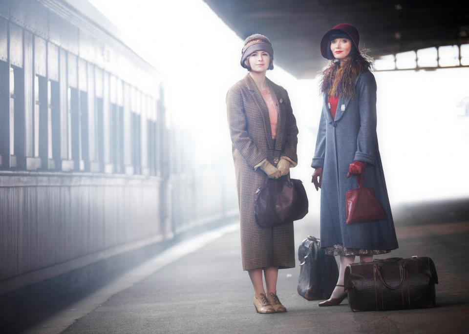 Miss Fisher at the train station in a fabulous coat