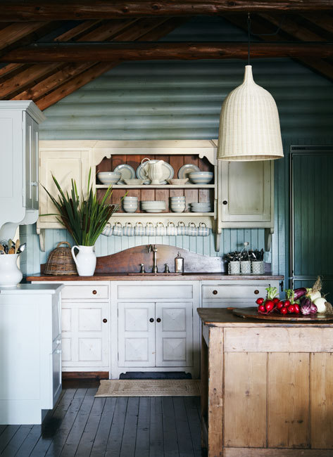 cottage kitchen with wood backsplash by colette van den thillart | kent kitchen works